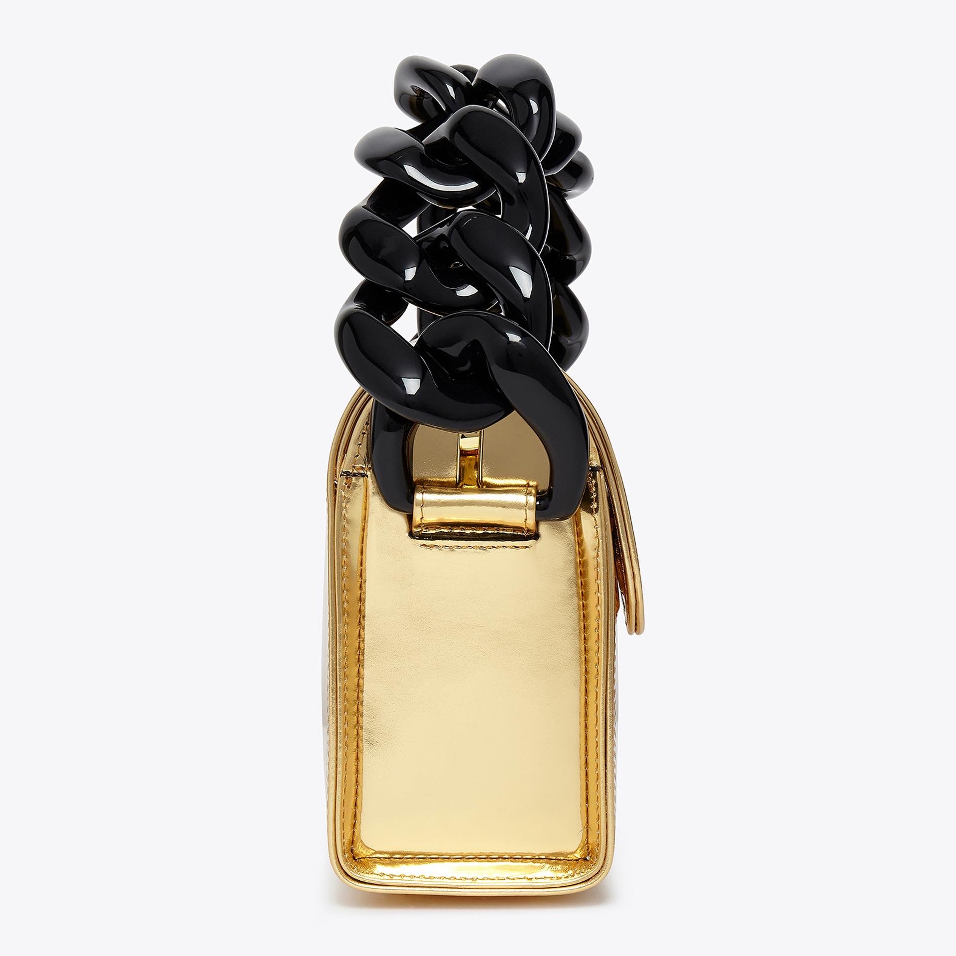 gold handbag with a black handle