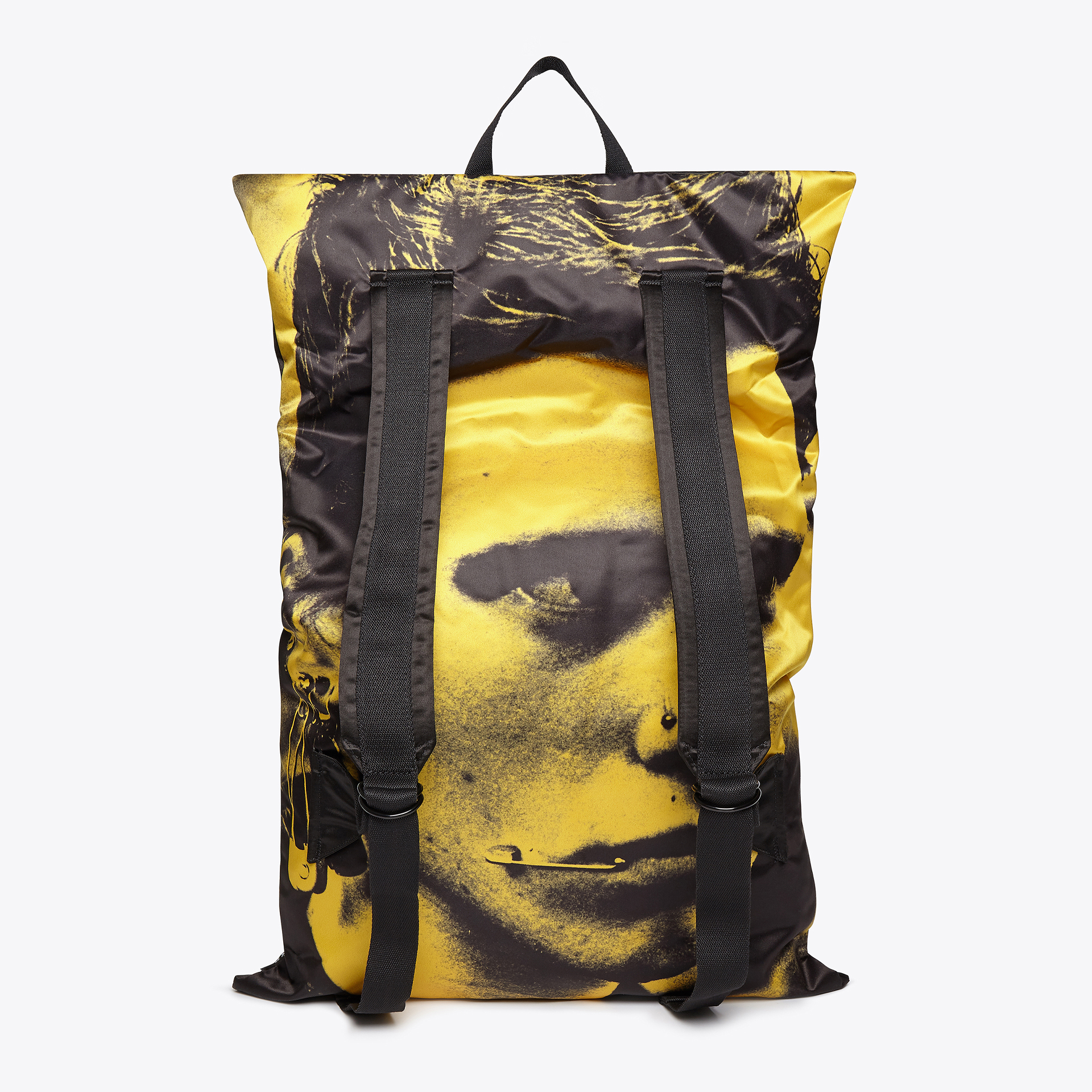 yellow backpack with an illustration of a persons face