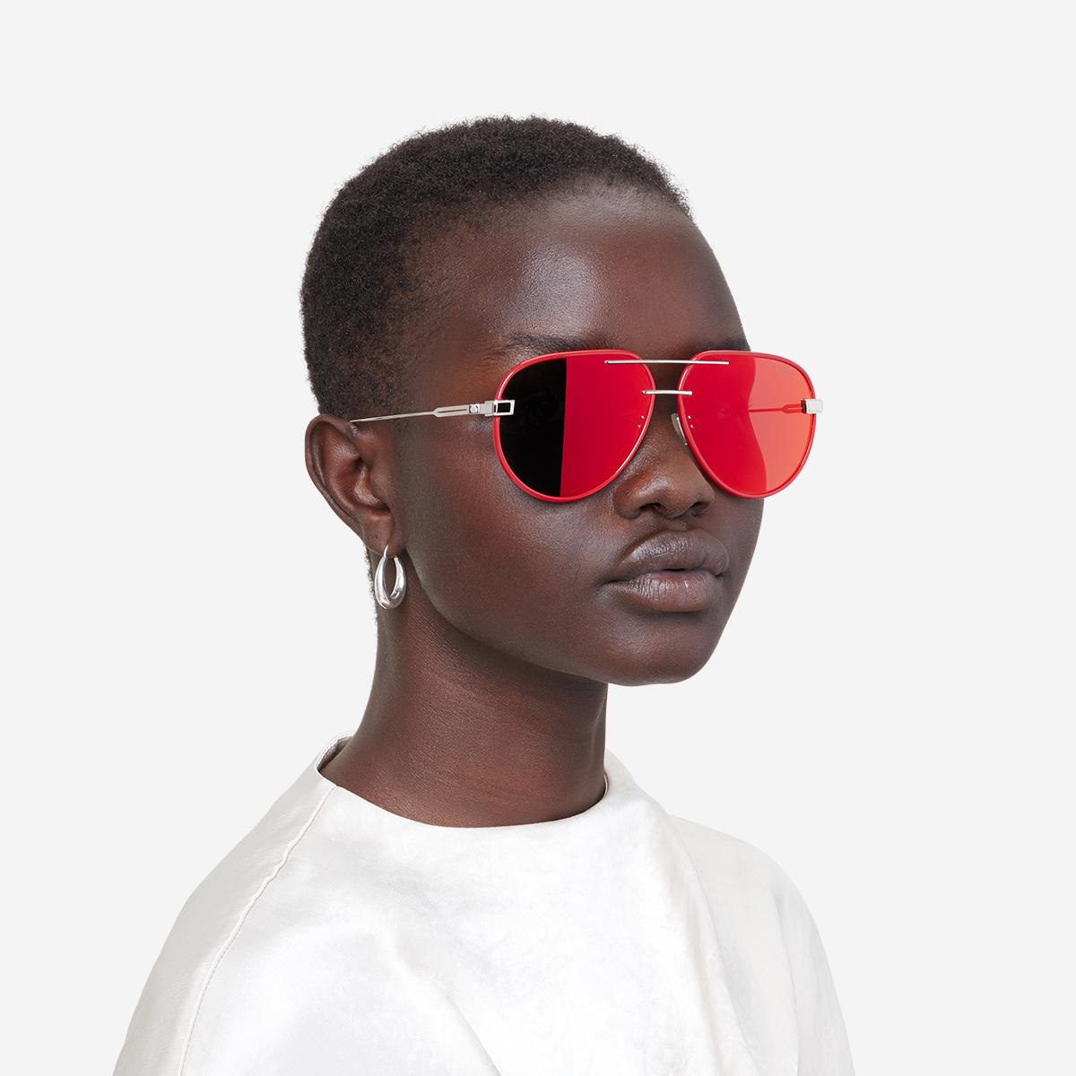 womenswear model wearing red reflective sunglasses
