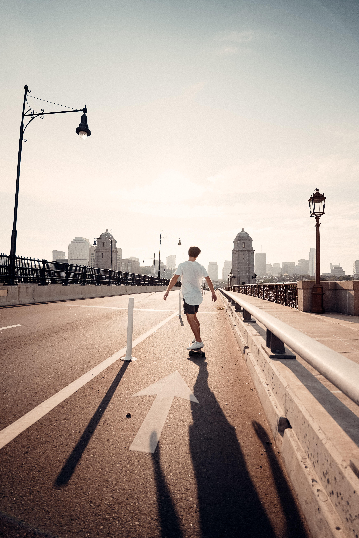 Sage Delaney skating over a bridge in Boston, MA