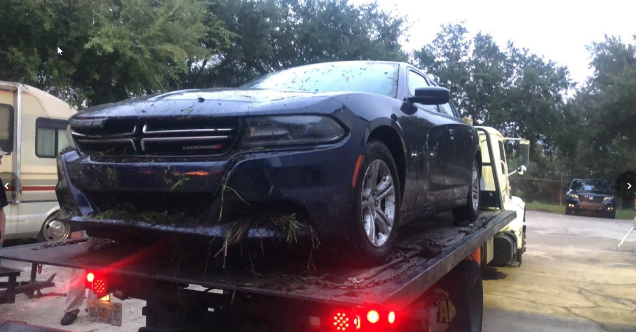 Dodge Charger On Flatbed Tow Truck