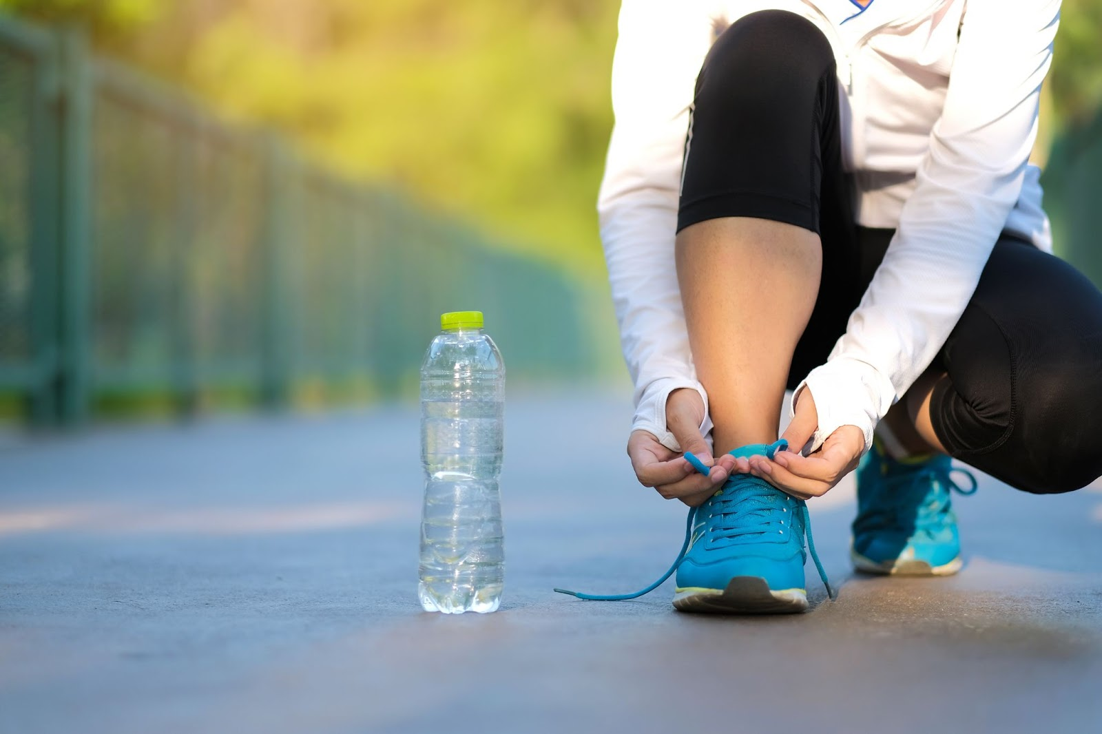 Wake up tired: A close up of a woman tying her shoe before going for a run