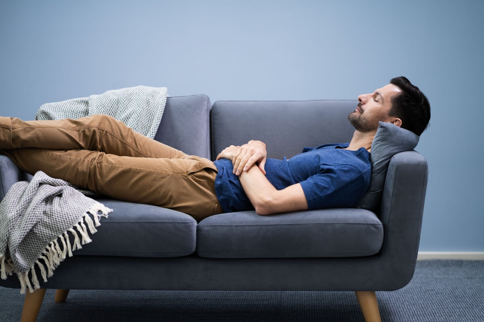 Sleeping during the day: A man naps on a couch