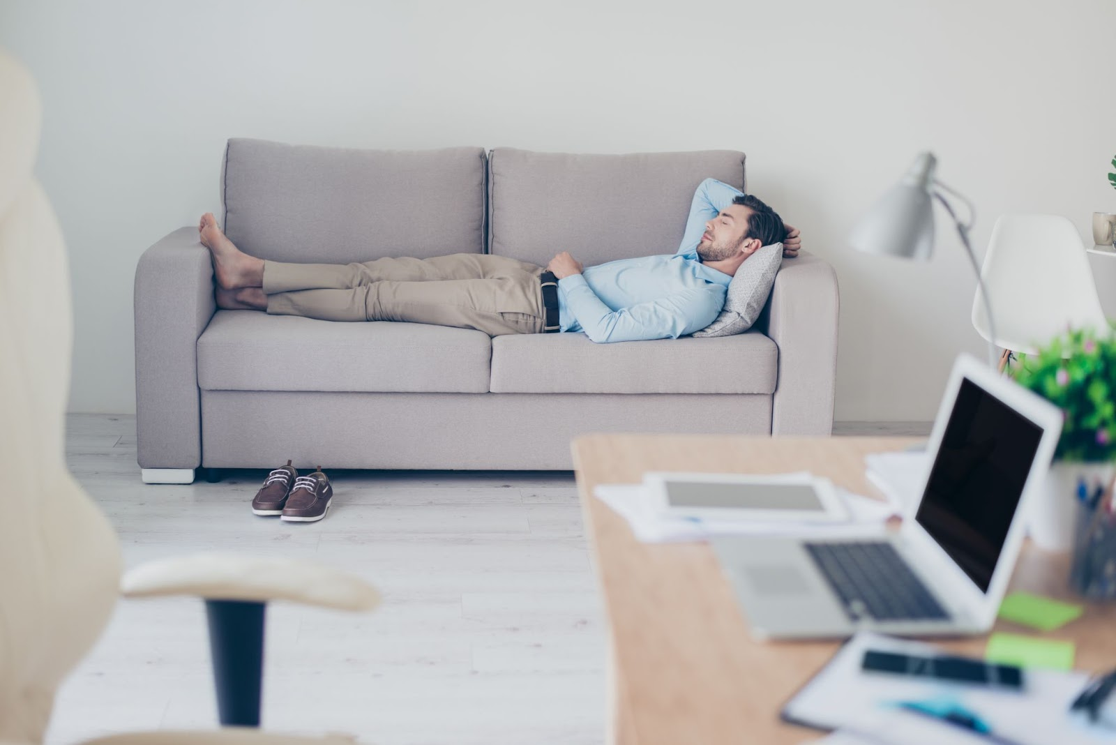 How to feel more awake: A man naps on the couch