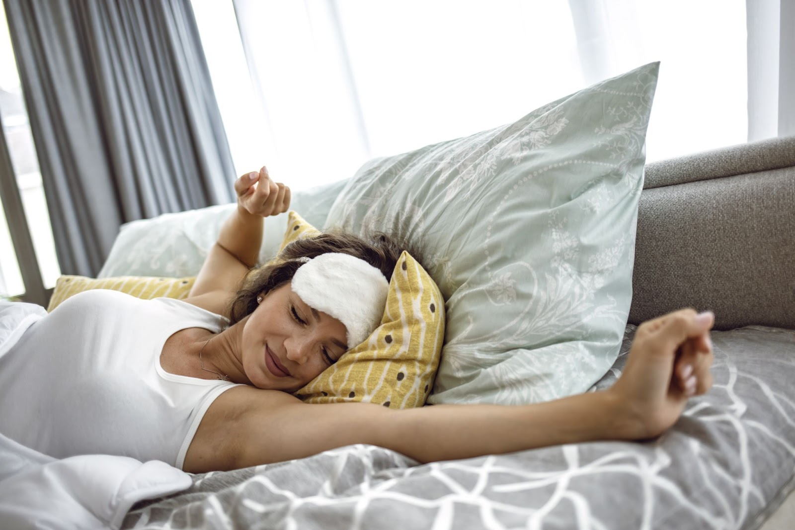 Natural energy: A woman stretches her arms as she wakes up