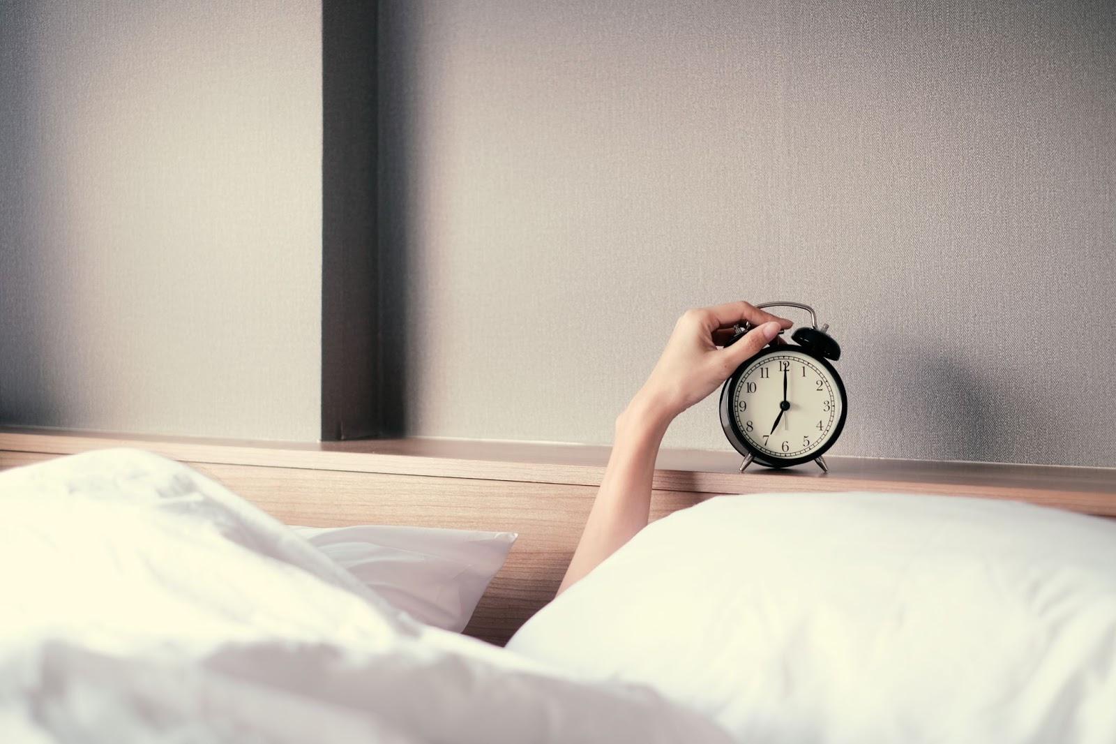 Natural energy: A hand reaches for an alarm clock
