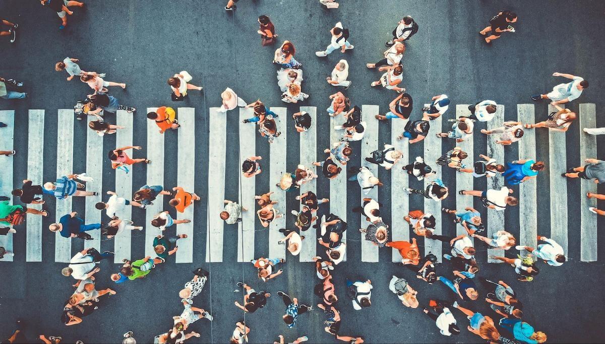 Social jetlag: A crowd walks across a crosswalk