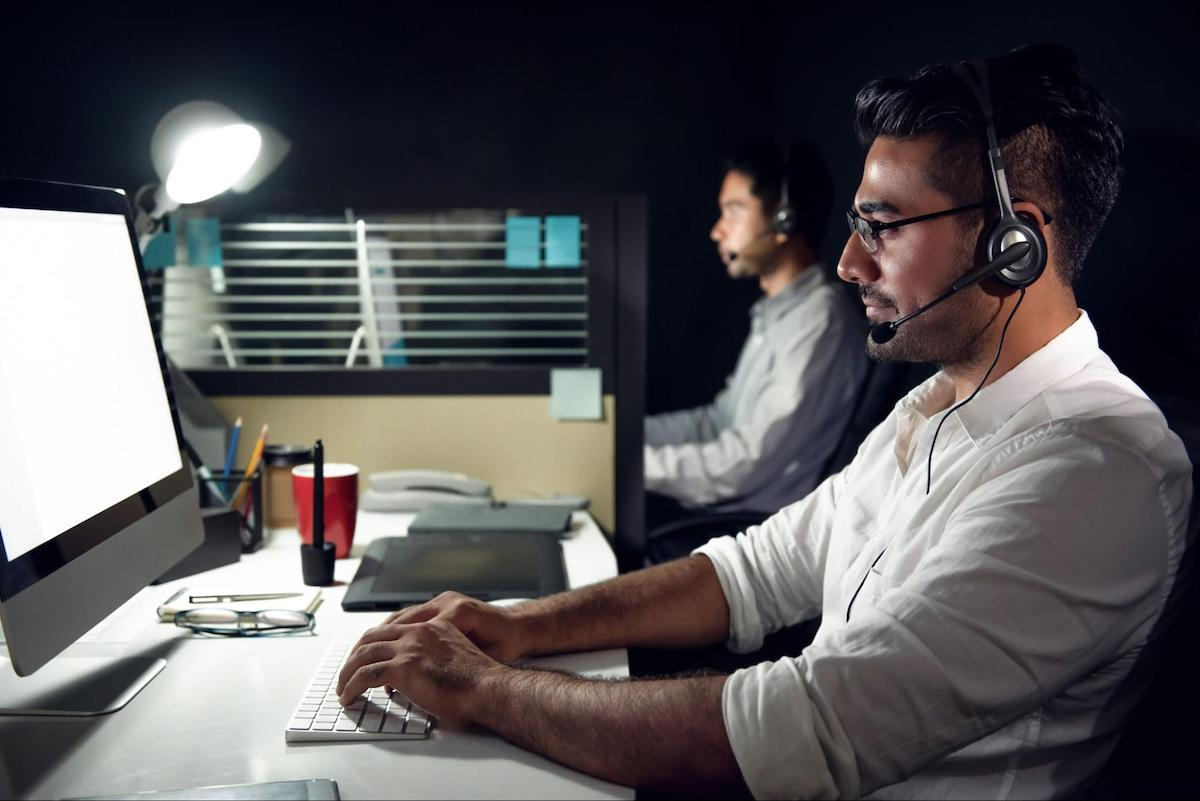 Excessive daytime sleepiness: A man works on a computer at night