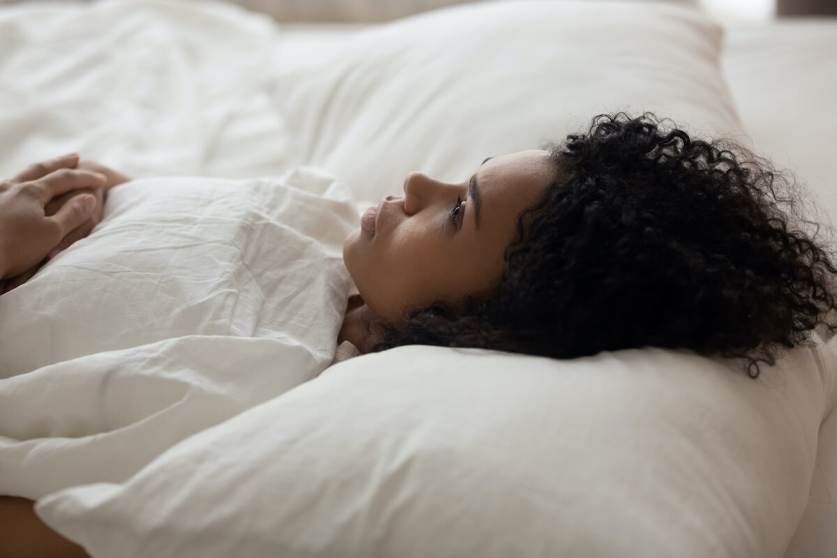 Anxiety and sleep: woman lying awake in bed