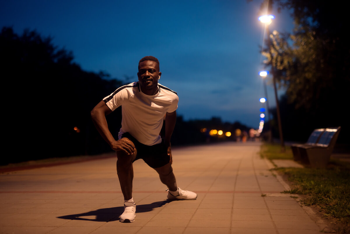 Exercise before bed: man stretching his legs