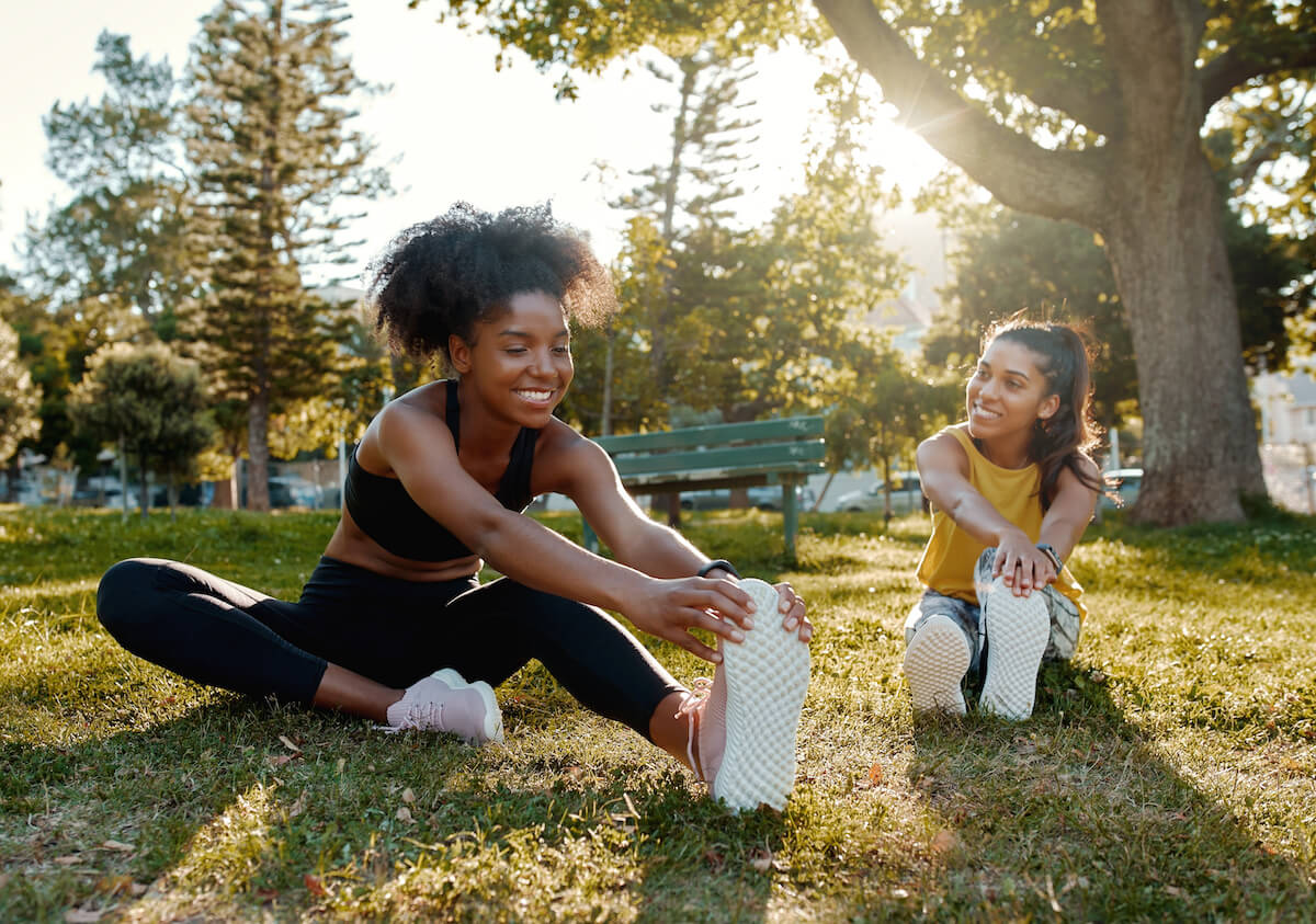 Two women stretching outdoors