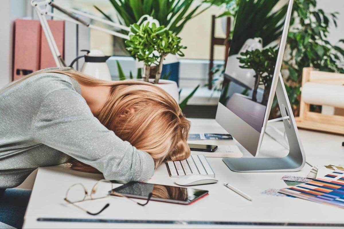 How to focus better: woman sleeping on her desk
