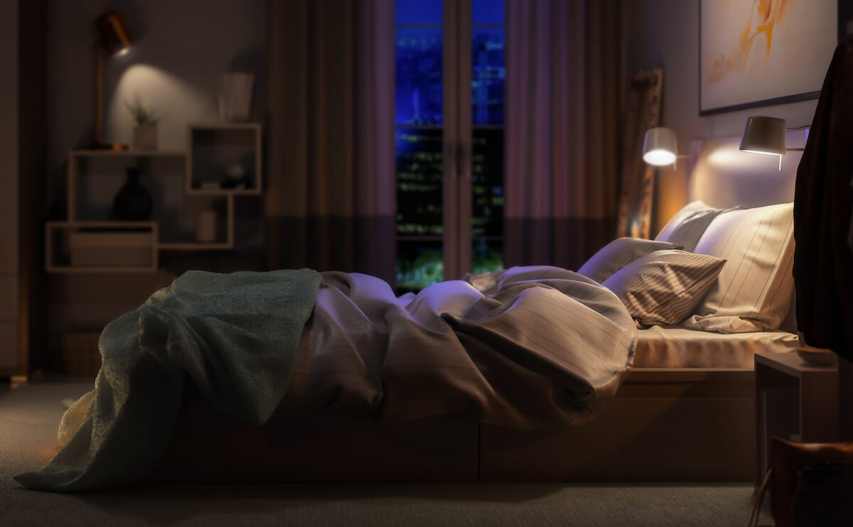 Why am I sleeping so much: A cozy bedroom at night
