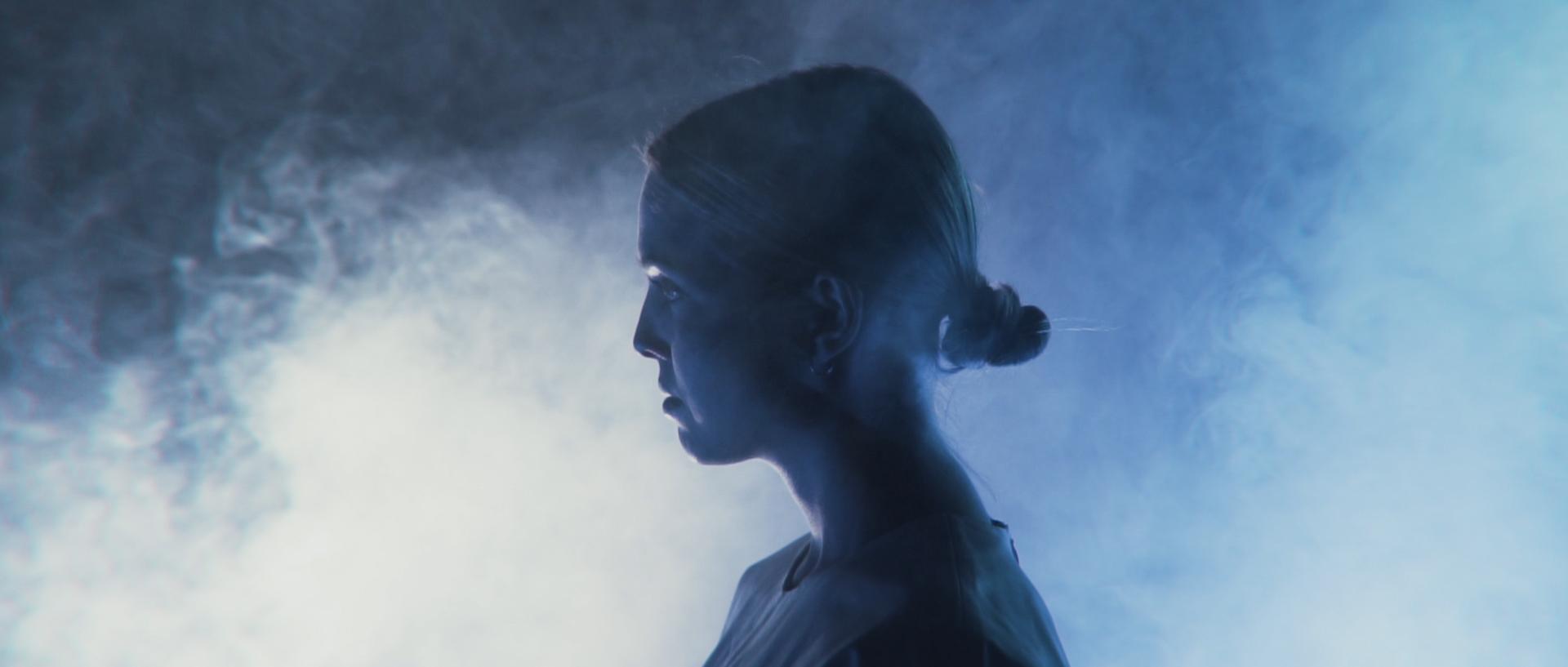 Girl standing in smoke