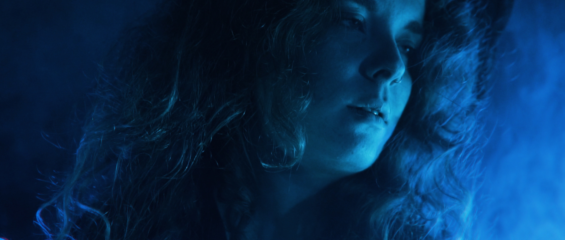 close up of a girl in blue light