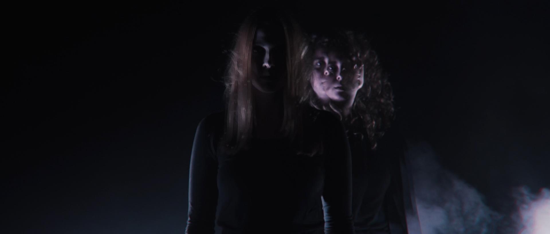 Two girls standing in smoke