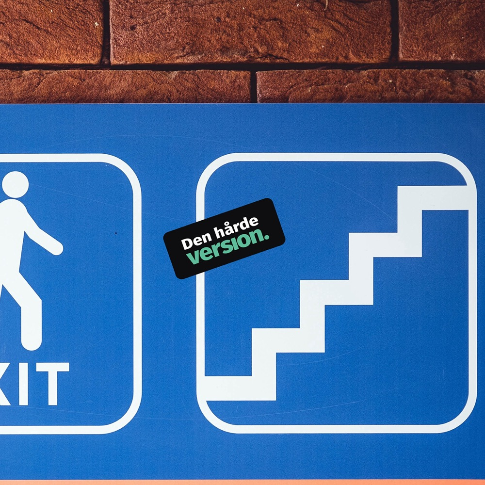 Exit-sign with sticker