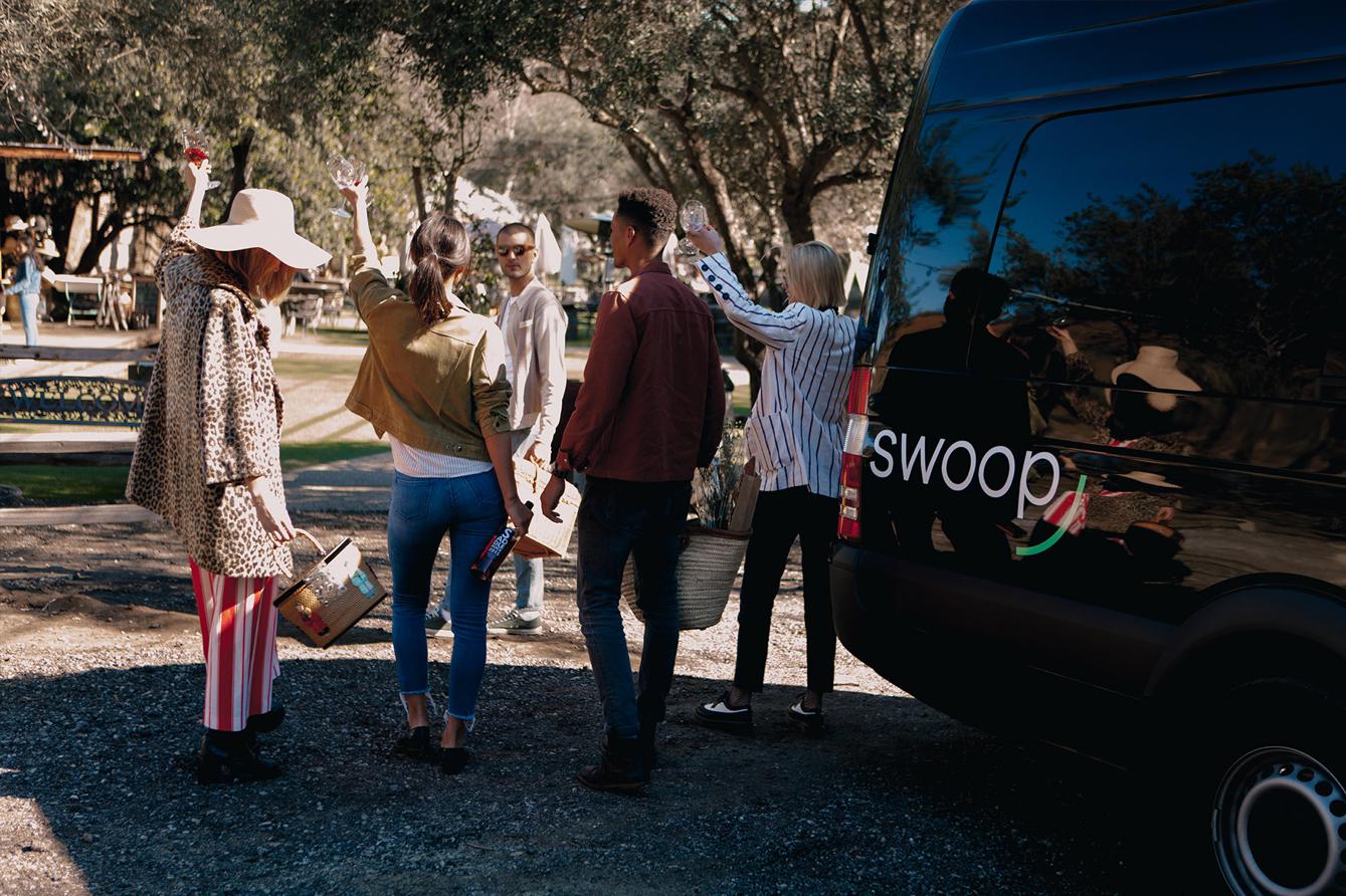 People walking around a van