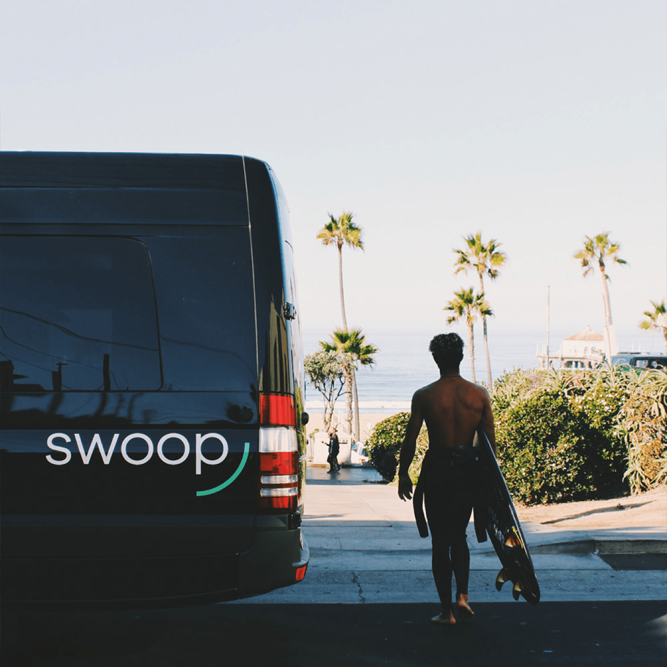 Swoop van with person walking