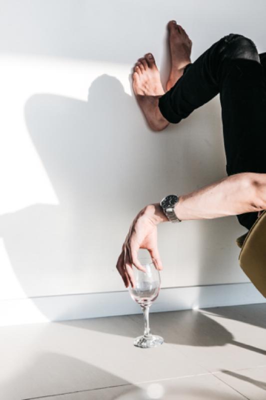 Man holding onto a wine glass