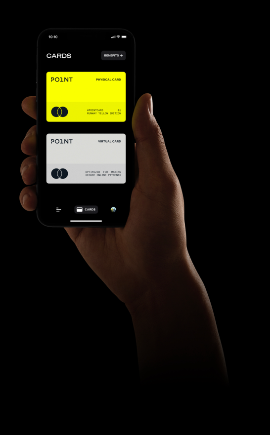 Person holding yellow Point card on iPhone