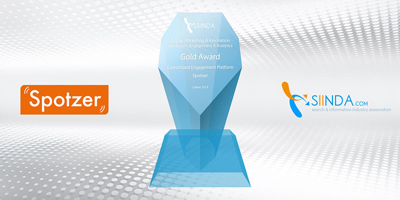 Spotzer and SIINDA logos on background banner with Gold Award trophy