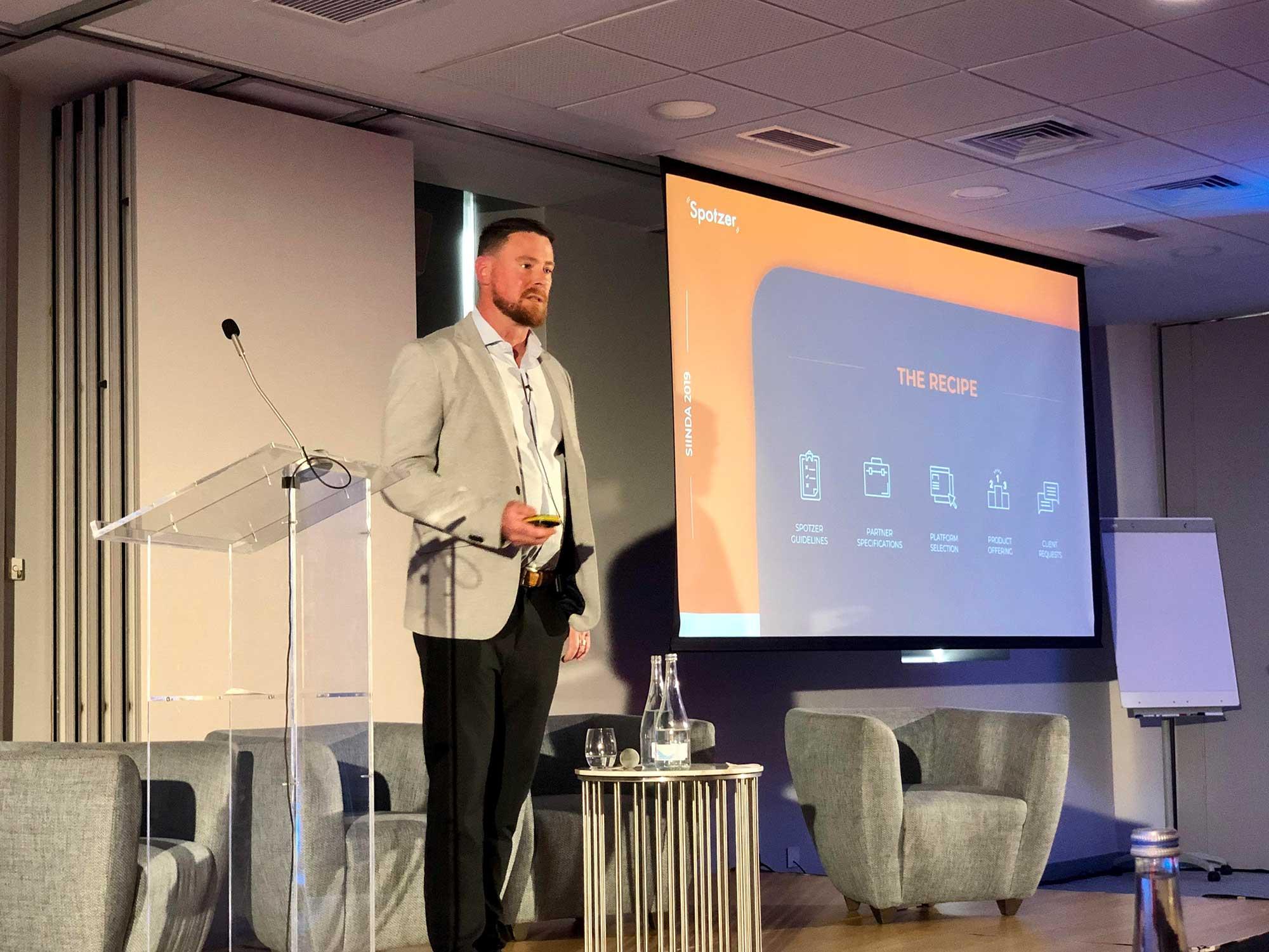 Spotzer employee talking at SIINDA summit in Lisbon