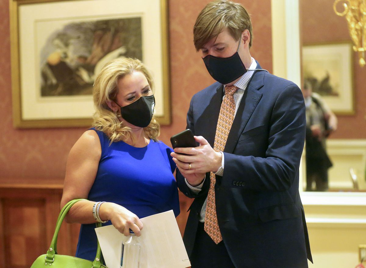 Arkansas Attorney General Leslie Rutledge, left, talks with Adam Piper, executive director of the Republican Attorneys General Association, after an association press conference about Democratic vice presidential candidate Sen. Kamala Harris' record at The Grand America Hotel in Salt Lake City on Wednesday, Oct. 7, 2020.