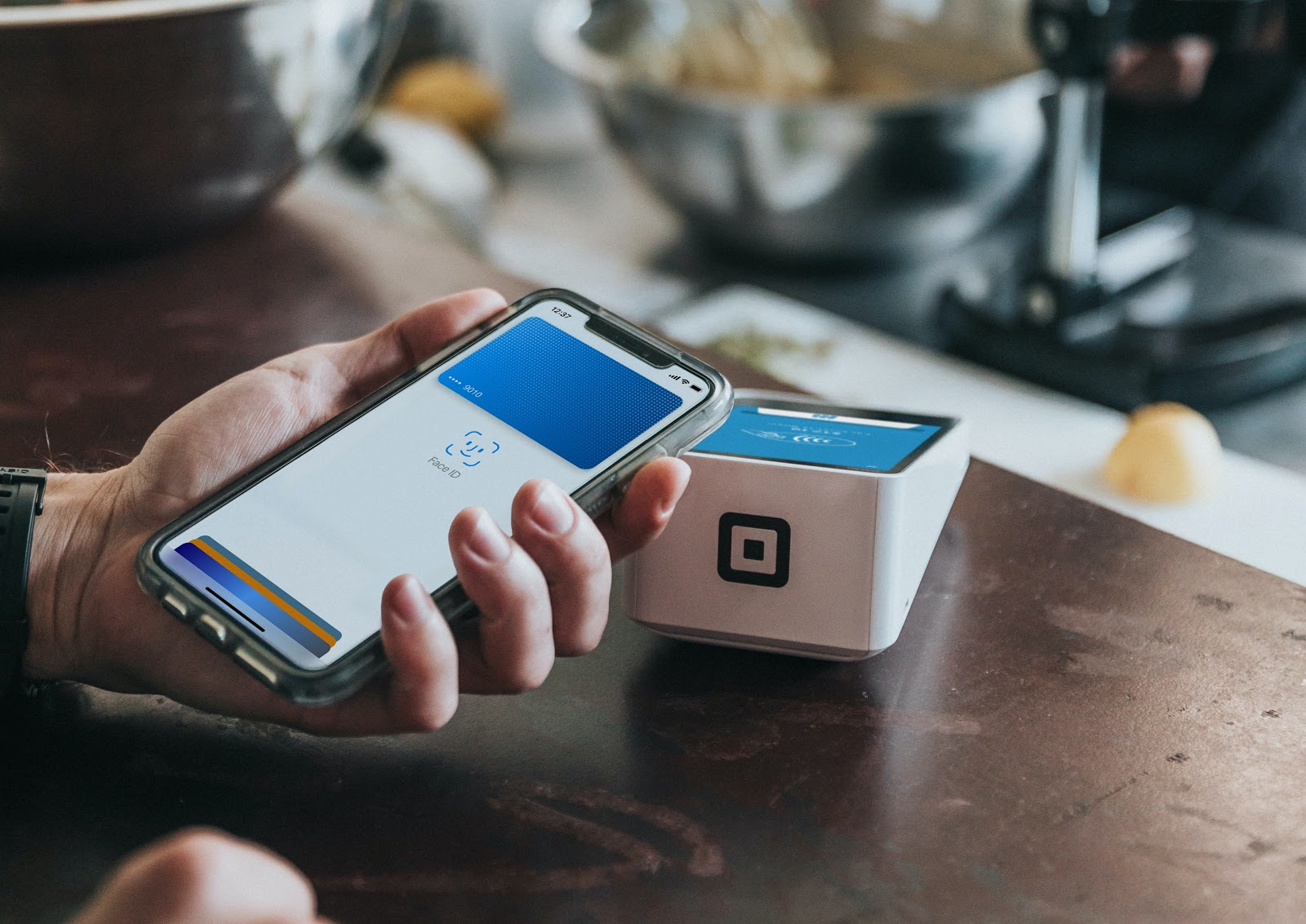 Image of a phone doing apple pay.