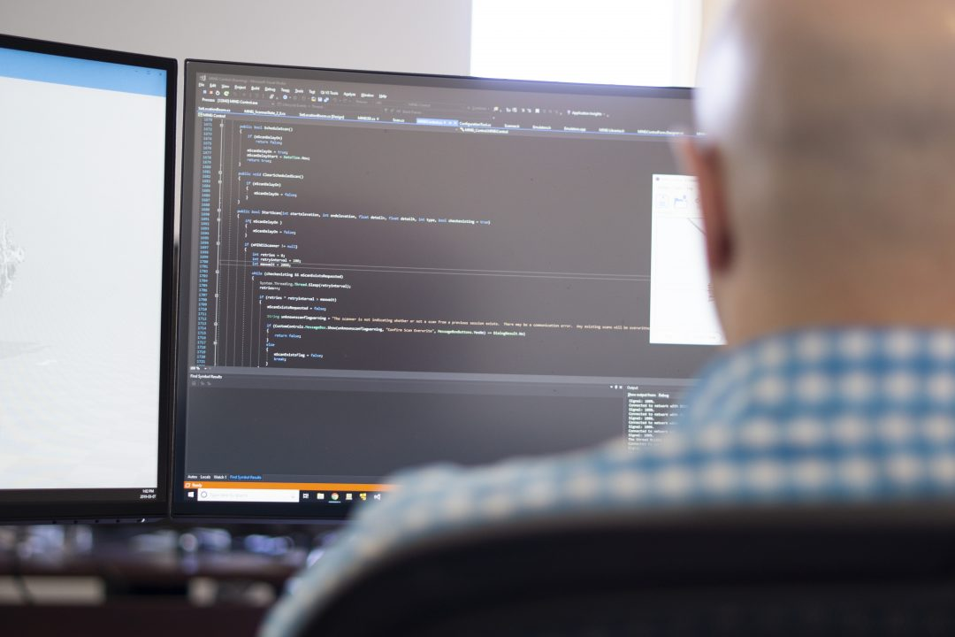 Developer looking at code for an app
