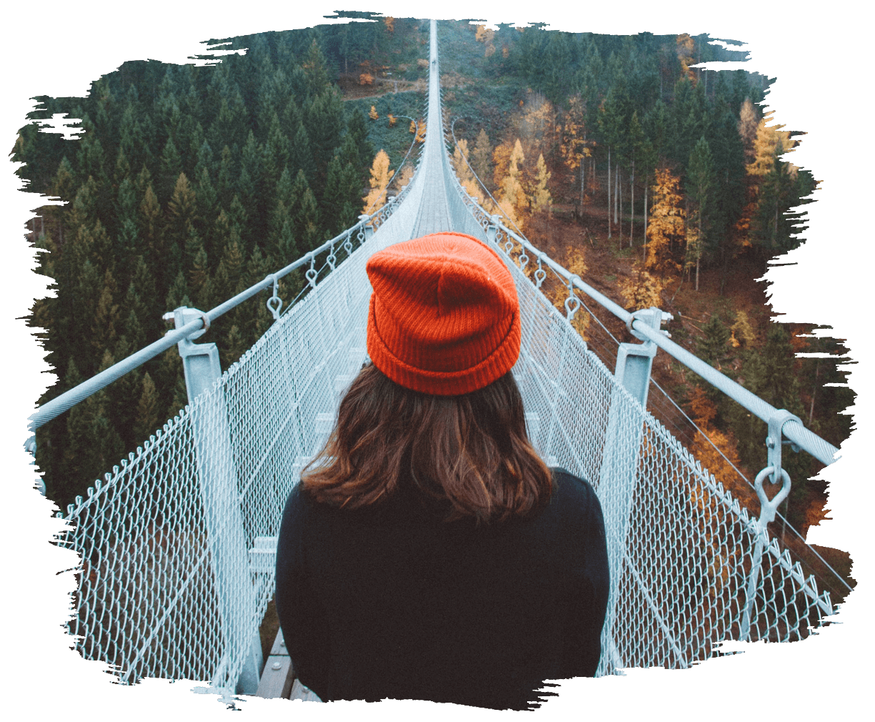 This is an image of a person looking down over a bridge walk way