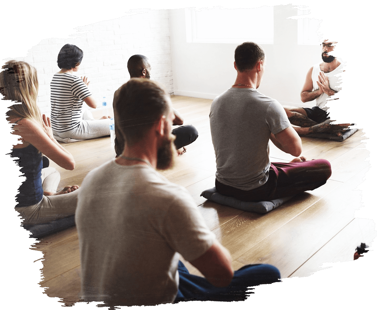This is an image of a ta group of men practicing holistic mediation