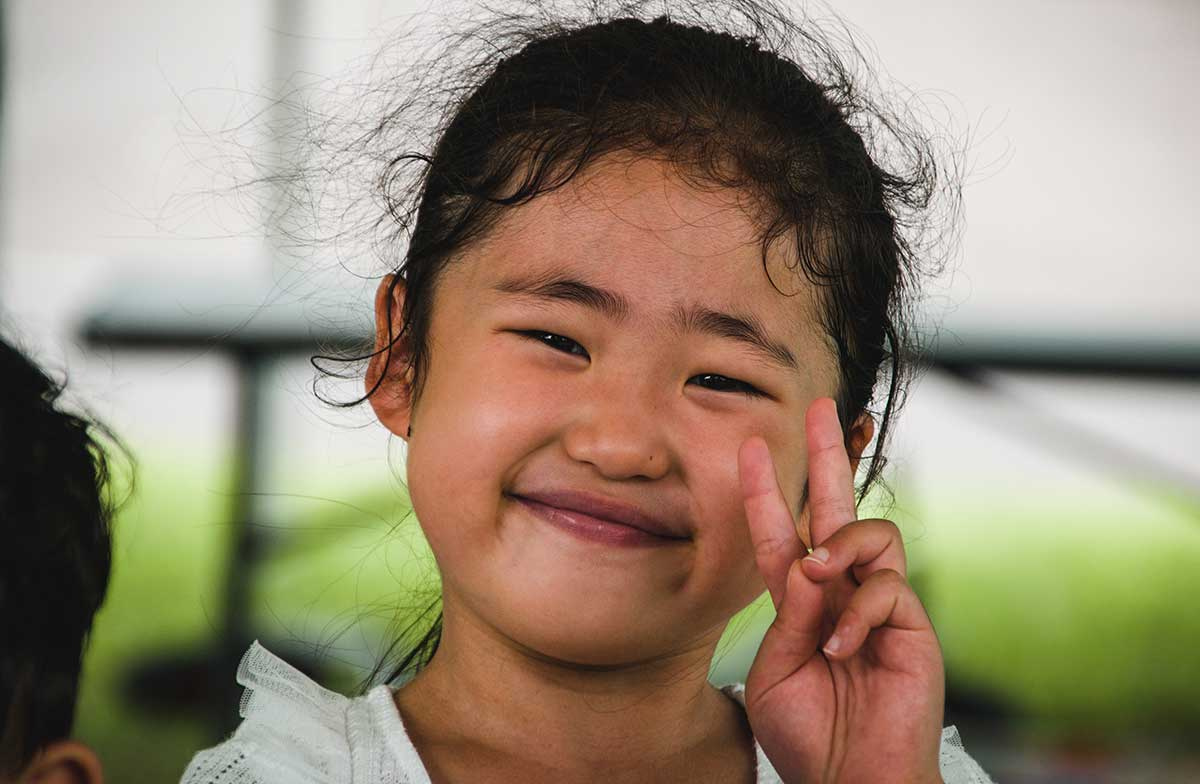 Young child with peace sign