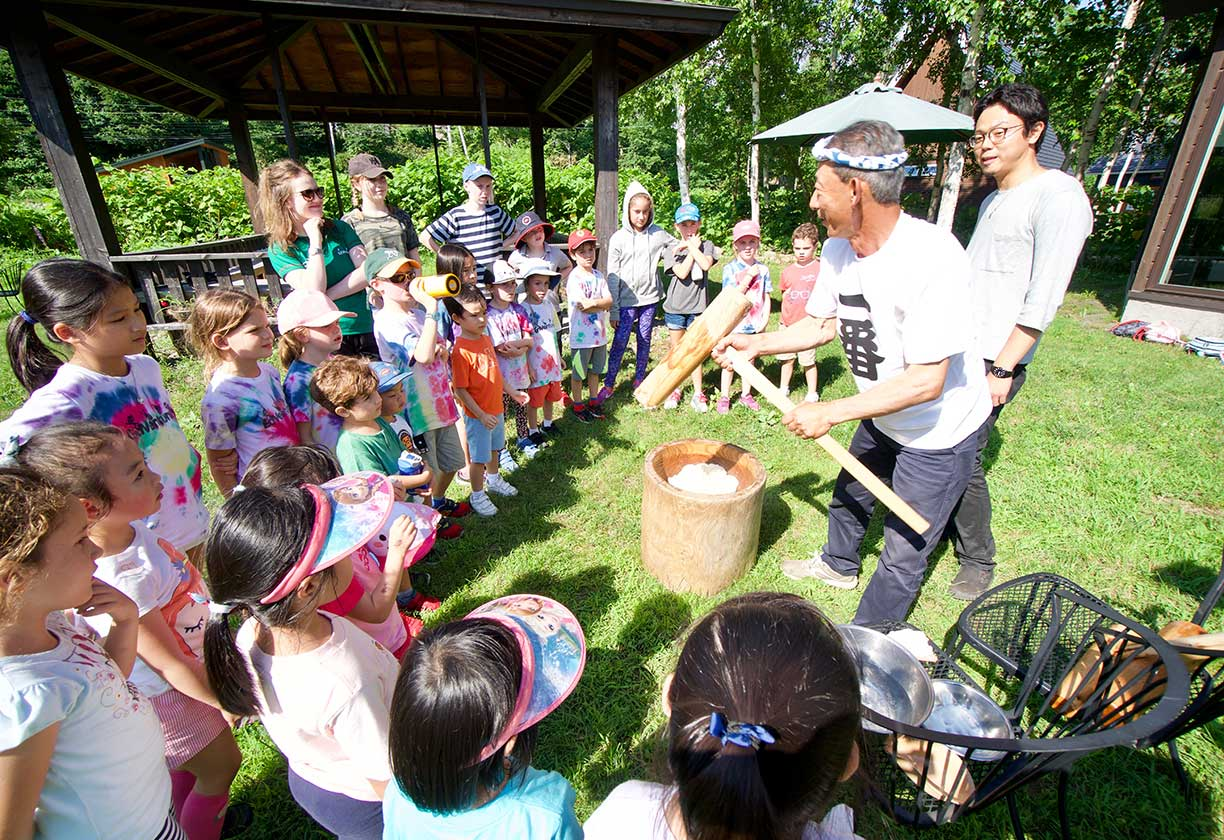 Children making mochi outdoors for summer camp