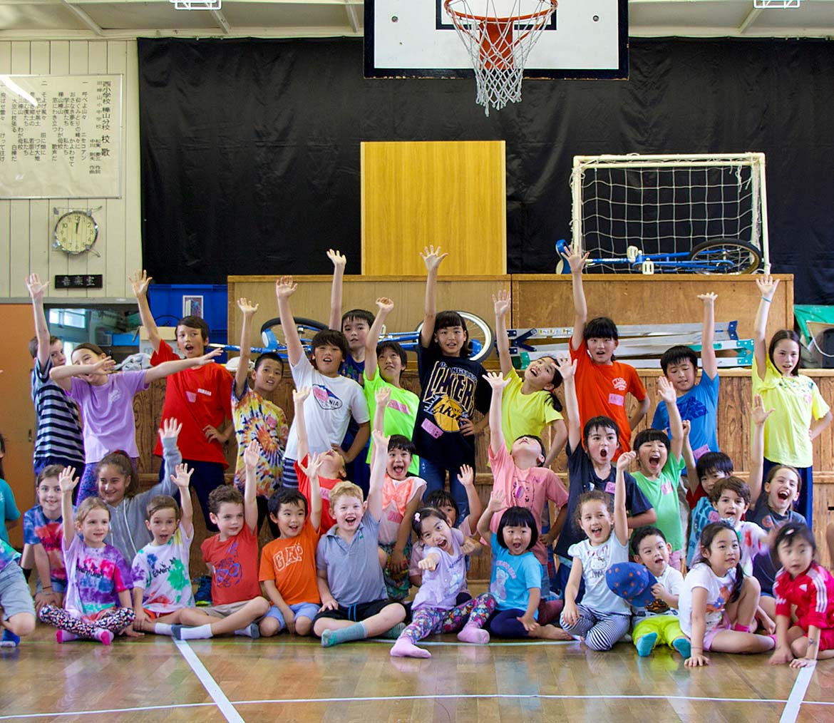 Group of children part of summer camp at local primary school