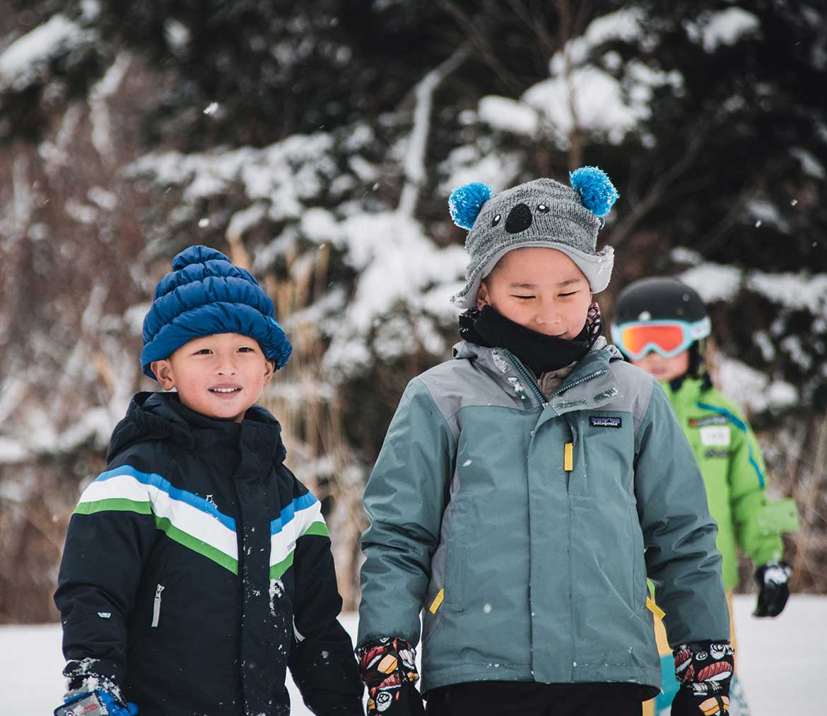 Two young children out in snow