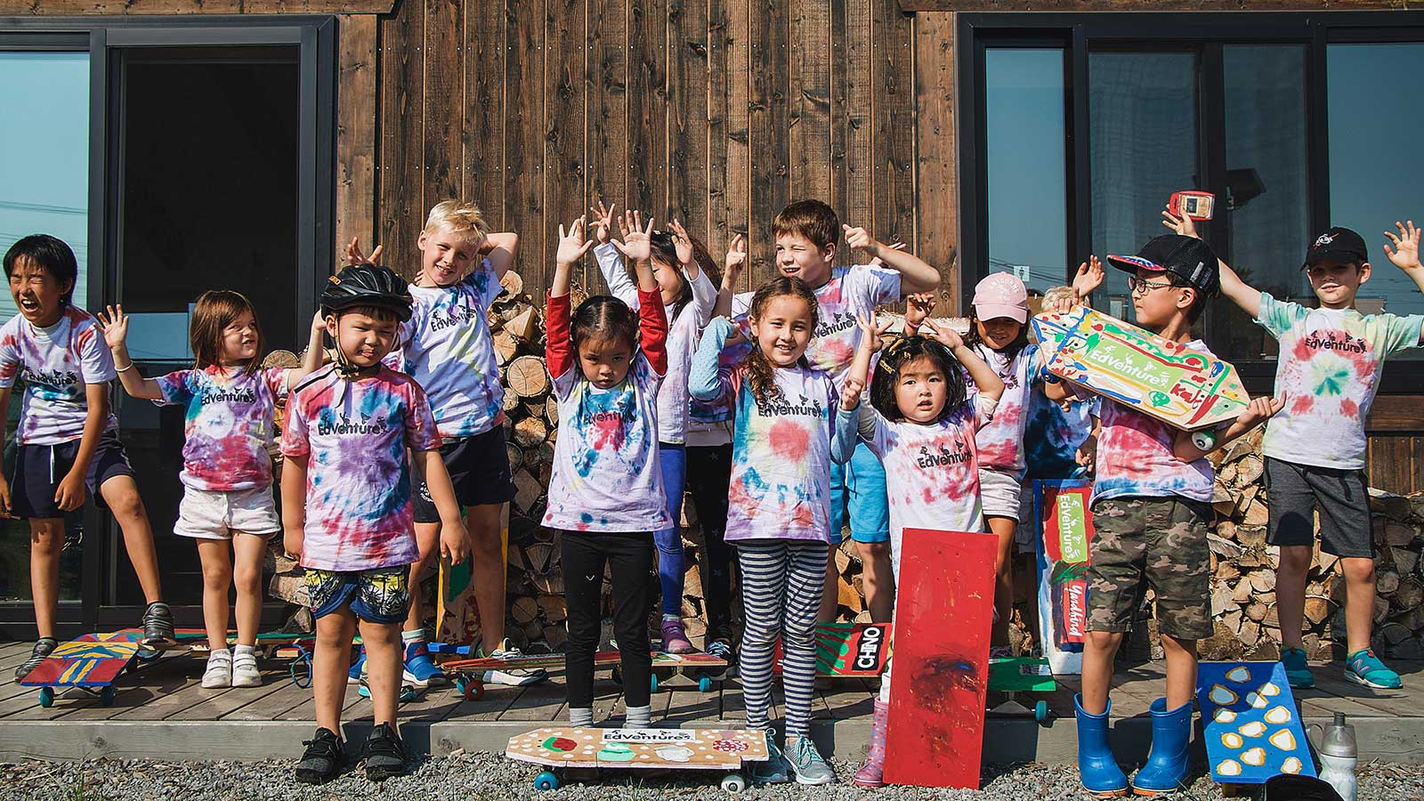 Group shot of children at summer camp with tie dye shirts