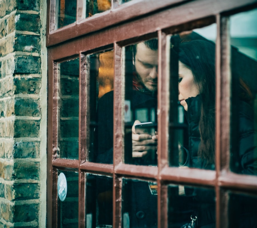 Couple on Phone through Window