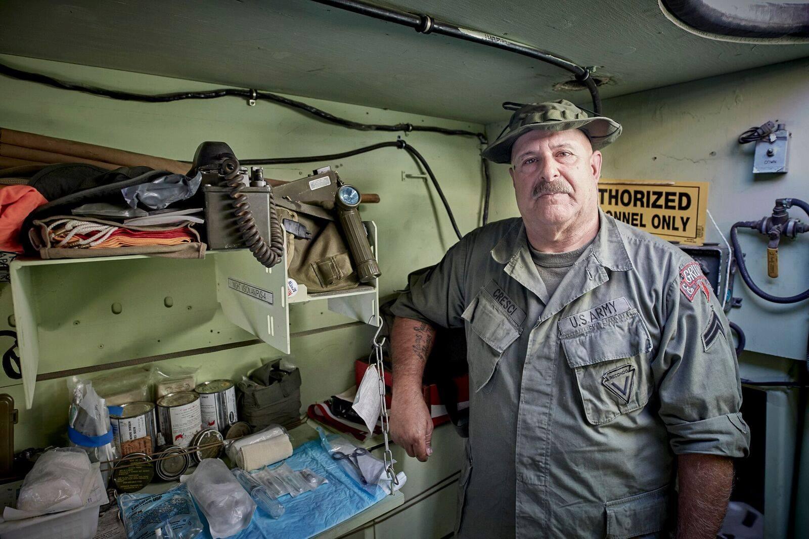 EFF volunteer educator in the M577  vehicle display.