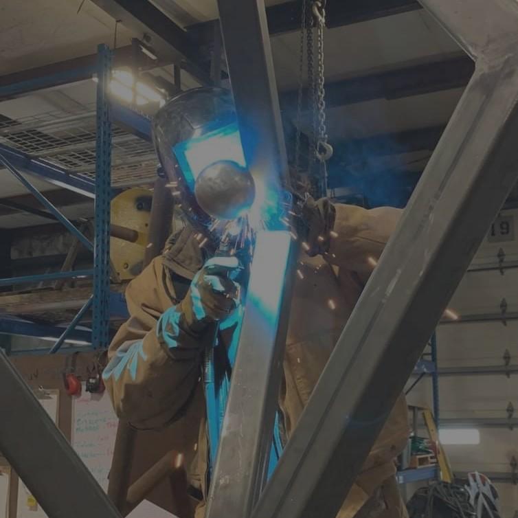 guy welding a metal beam