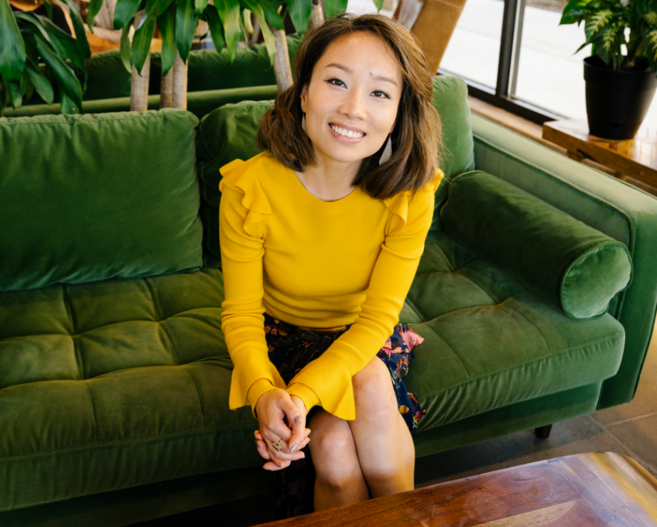 Allison Li sitting on a couch
