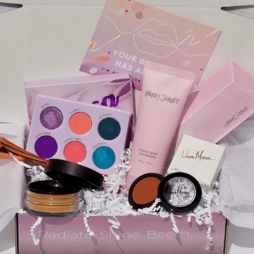 beem box unboxing with honey jarret foam cleanser, eyeshadow palette, moira setting powder, vera cosmetics blush, and fluffy pink powder brush