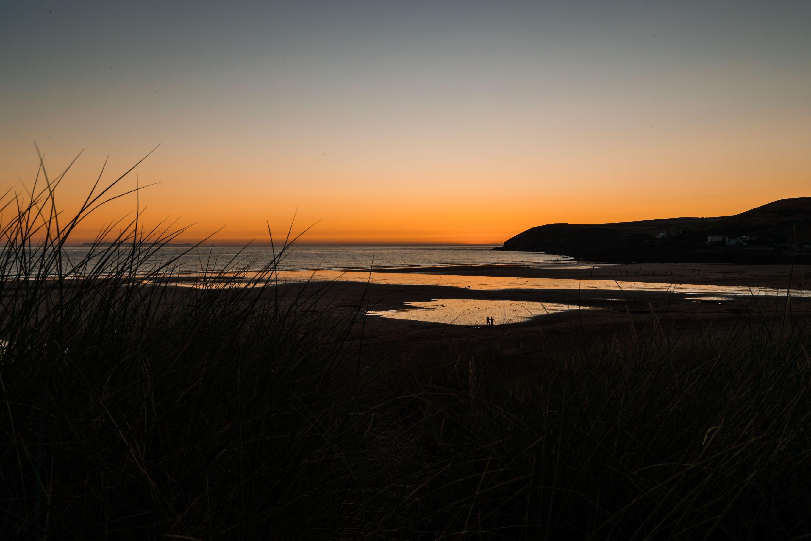 Sun setting over an english beach.