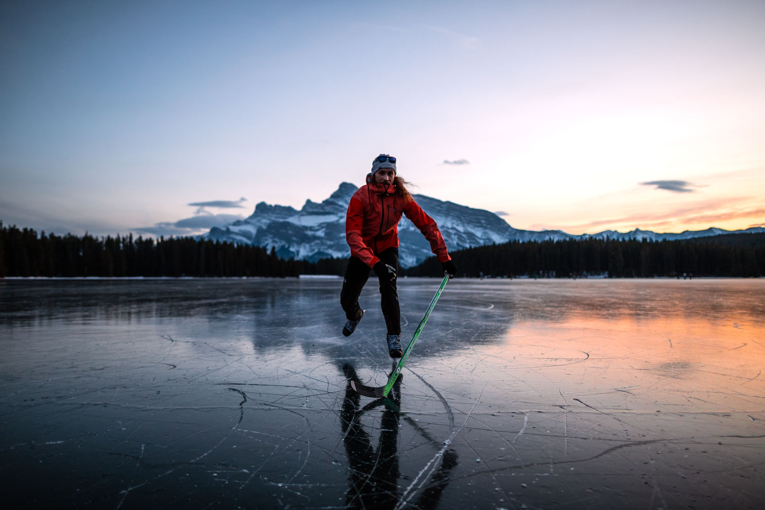 Ice skater on frozen Canadian lake.