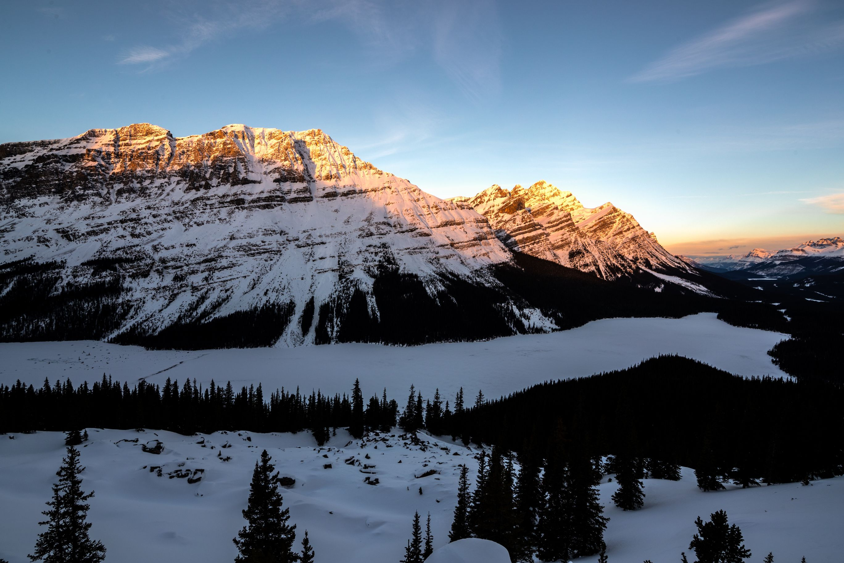 Sunset over frozen lake in the Canadian Rockies.