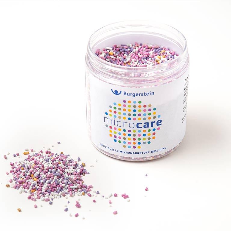 Kunststoffdose gefüllt mit farbigem Microcare Granulat