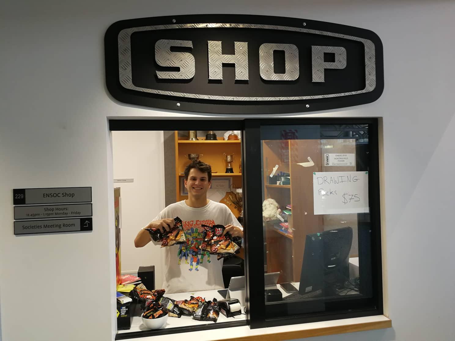 Boy working at ENSOC shop