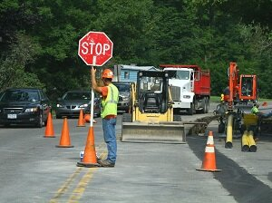 Flagger Holding Stop Sign in Work Zone