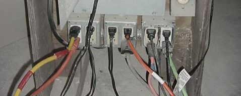 Common temporary set-up of an electrical panel with GFCI outlets found on a construction site.