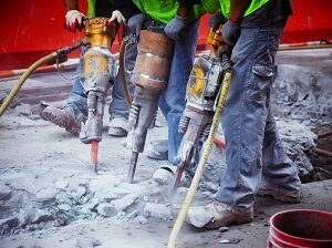 Three Workers Using Jack Hammers